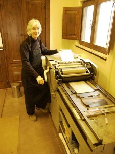 Founder Cathy DeForest letterpress printing at Farmhouse studio