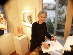 Founder Cathy DeForest at etching press