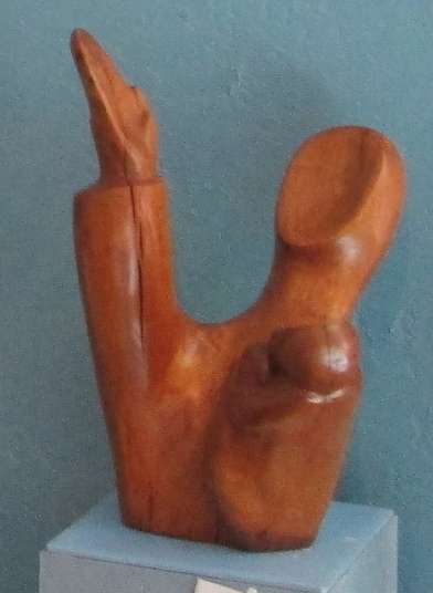 Free Us From Tyranny! Walnut Sculpture of Mother with one arm outstretched to heaven and the other arm embracing a Child by Artist J. Ellen Austin