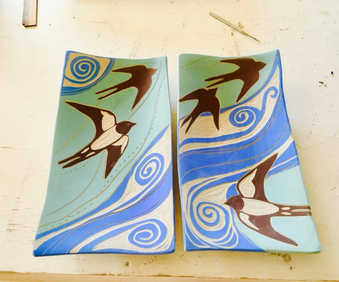 Julia Janeway hand carves swallows on clay.  This piece will then be fired twice and part of her show with Denise Kester at Hanson Howard Gallery the month of October 2017.